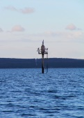Sailing past cormorants on the marker, Eastern Cove